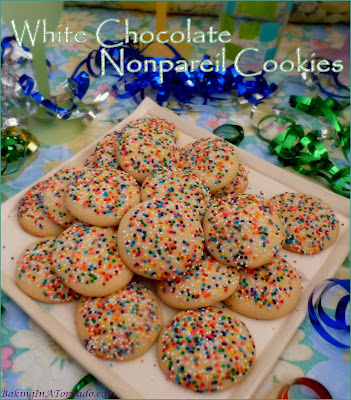 White Chocolate Nonpareil Cookies are perfect for any occasion. White chocolate infused cookie dough, dipped in multicolored nonpareils for a pretty, crunchy topping. | Recipe developed by www.BakingInATornado.com | #recipe #cookies
