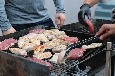 Two Men Barbecuing Steaks and Chicken