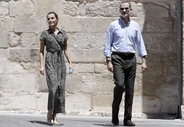 The Queen wore a new bow-detail jumpsuit by Mango. Queen Letizia wore Mango bow detail jumpsuit, gold earrings