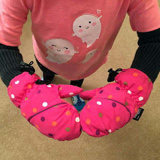 Child wearing home made long snow mittens