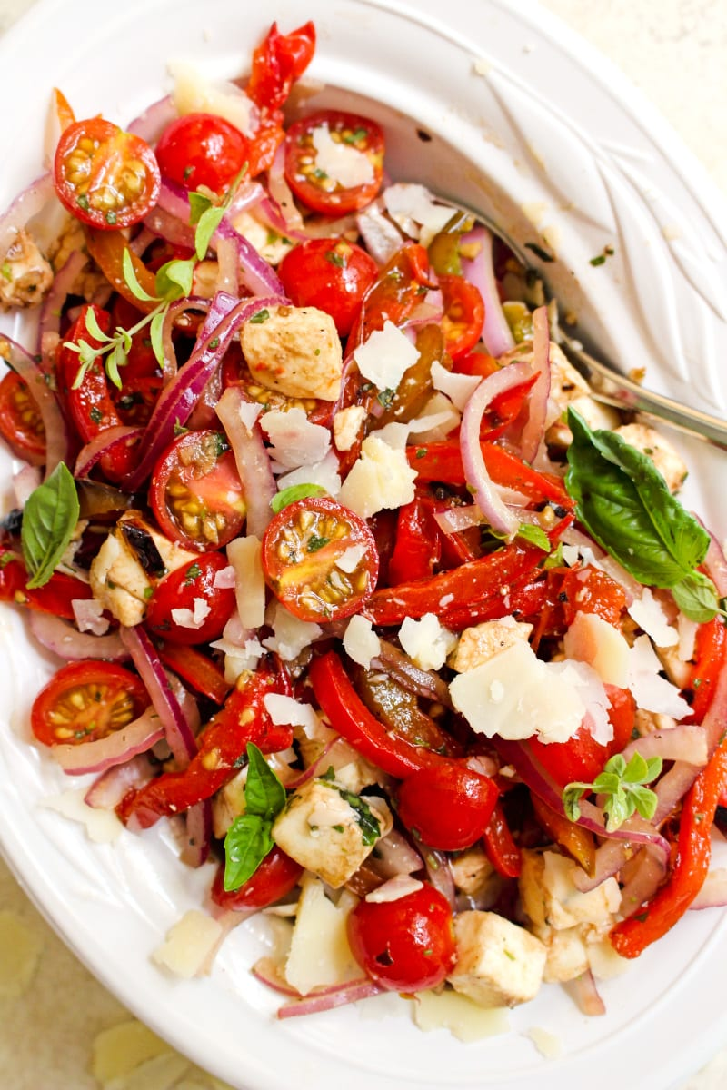 This Grilled Bell Pepper, Tomato, and Mozzarella Salad is bursting with summer flavors! It's the perfect fresh side dish to serve at a cookout. #sidedish #salad
