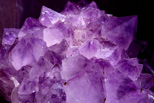 Image showing a cluster of amethyst, the violet / purple gemstone which is the birthstone for February
