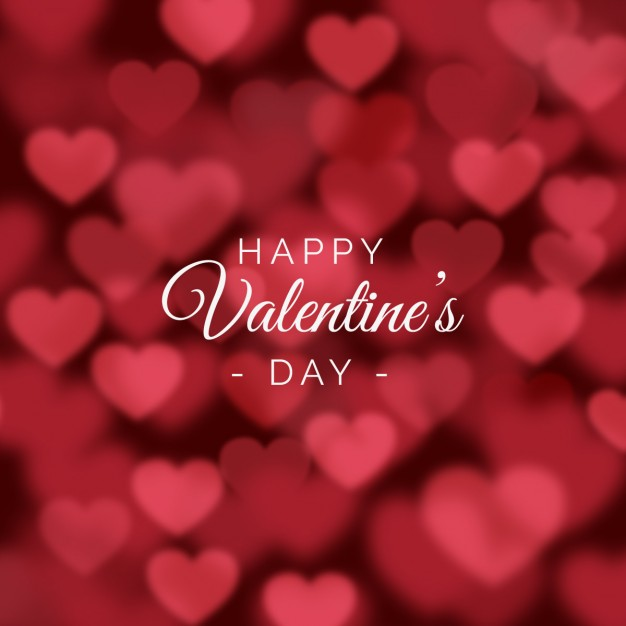 Valentines day background with blurred hearts Free Vector