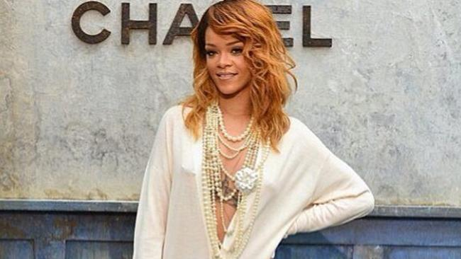 Rihanna wearing cascading ropes of pearls with Chanel logo