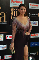 Hansika Motwani in Glittering Deep Neck Transparent Leg Split Purple Gown at IIFA Utsavam Awards 005.JPG