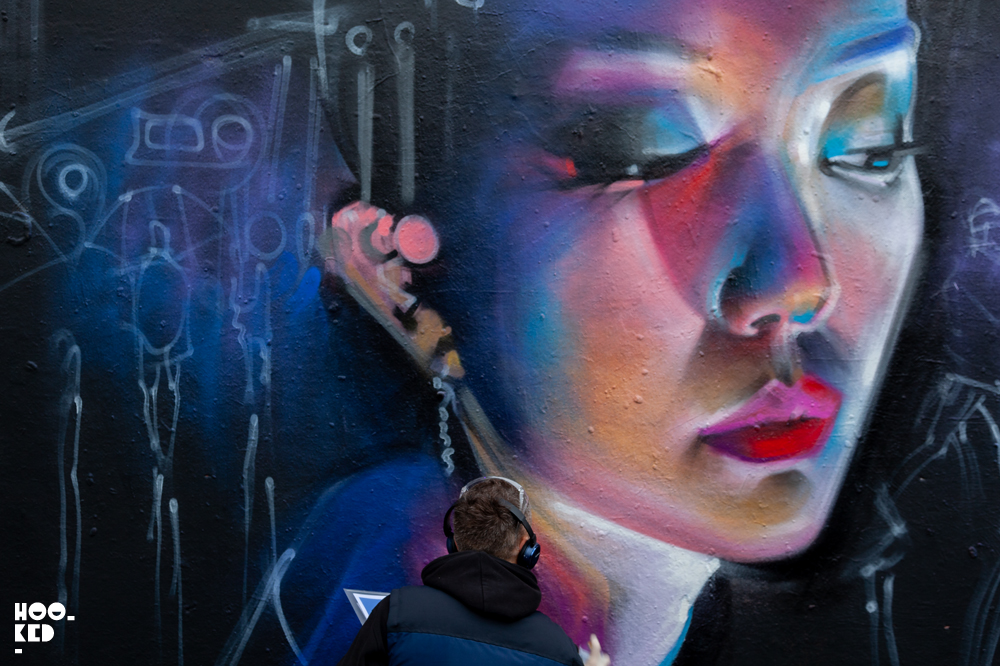 Shoreditch Street Art, London Street Artist Dan Kitchener at work on a mural
