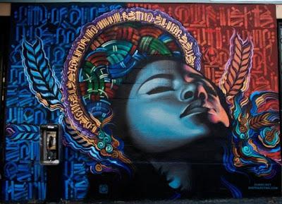 Arte Urbano  rostro de mujer escala de grisis