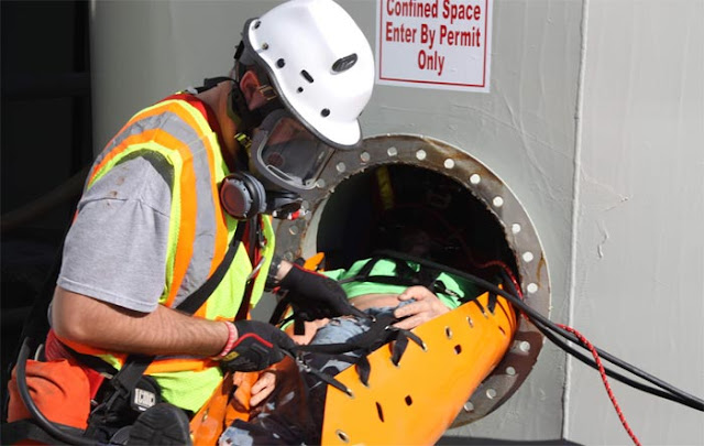 Picture conducting an enclosed space rescue operation drill