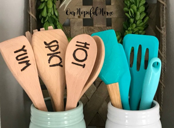 engraved wooden spoon spatula cooking kitchen mason jar boxwood wreath turquoise tools