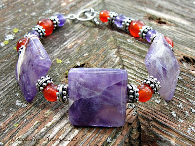 https://www.etsy.com/listing/87044917/healing-gemstone-bracelet-purple