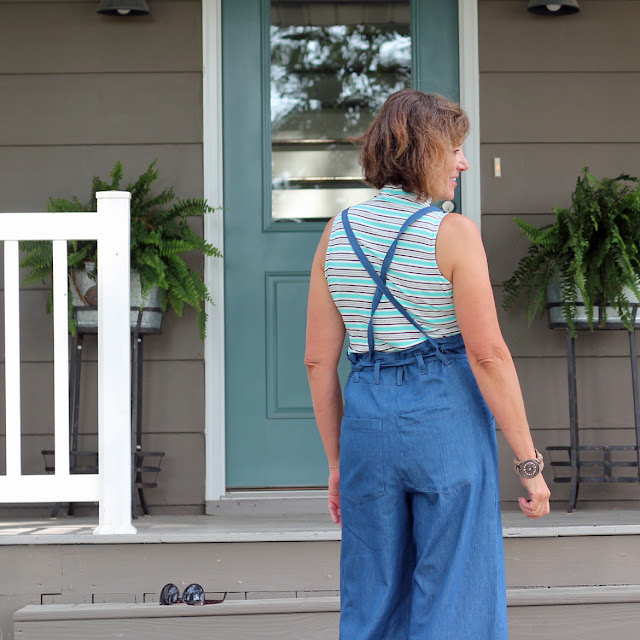 Sew House Seven's Burnside Bibs made from Style Maker Fabrics' Tencel Denim- back view with straps crossed