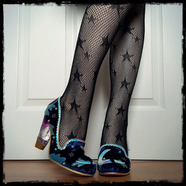 wearing Irregular Choice starry night perspex heeled shoes and star fishnet tights