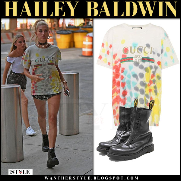 Hailey Baldwin in printed logo gucci t-shirt and black combat boots vetements dr martens july 20 2017 model street fashion