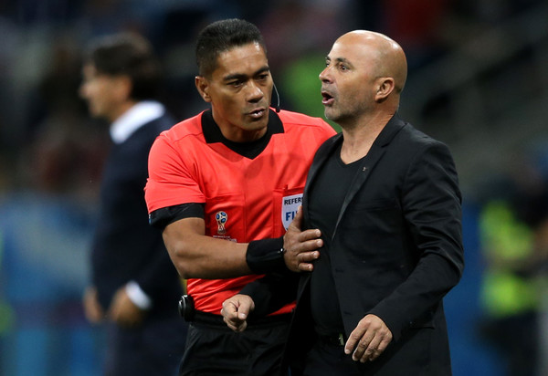 Fourth Official Norbert Hauata speaks with Jorge Sampaoli, Head coach of of Argentina during the 2018 FIFA World Cup Russia group D match between Argentina and Croatia at Nizhny Novgorod Stadium on June 21, 2018 in Nizhny Novgorod, Russia.