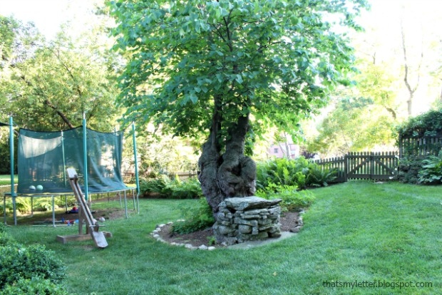 backyard with well and diy see saw