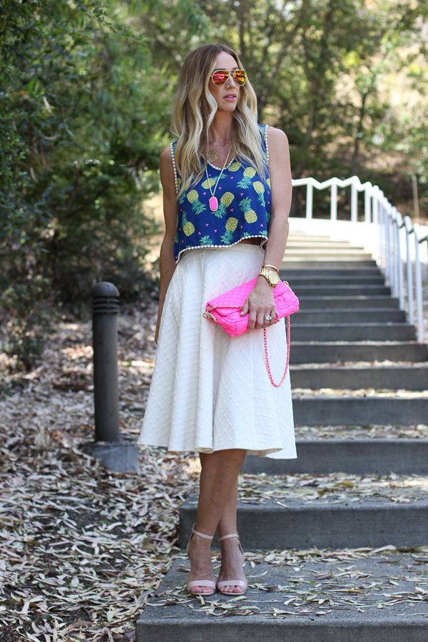 pink accessories with midi skirt