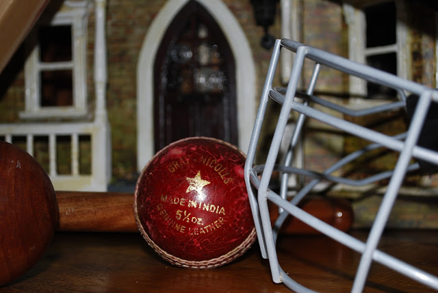 Cricket ball, cricket helmet and the Mini House
