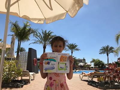 Child on holiday with diary