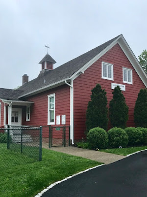 Red, barnlike building that houses Sagaponack School, a one-room schoolhouse