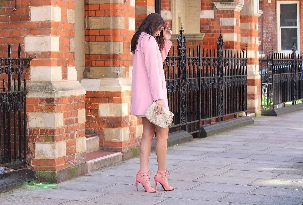 peexo fashion blogger wearing pink coat and pink lace up sandals for spring wedding season
