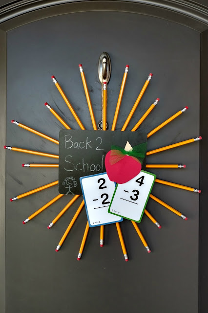 Easy $3 back to school wreath using dollar store supplies!