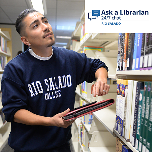 "Photo of a Rio Salado College student at the library, looking up at the stacks.  Banner at top reads: ""Ask a Librarian 24/7 chat Rio Salado"""