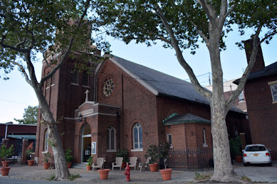 Red brick church facade facing north