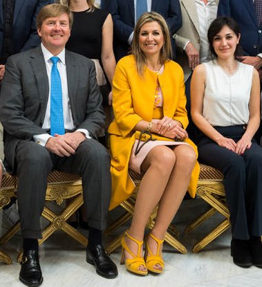 Queen Máxima wears NATAN Marigold Coat. King Willem-Alexander and Queen Maxima held a lunch at Hague Noordeinde Palace in the Hague