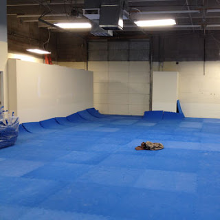 House of Dog Training Facility installing Greatmats dog agility mats