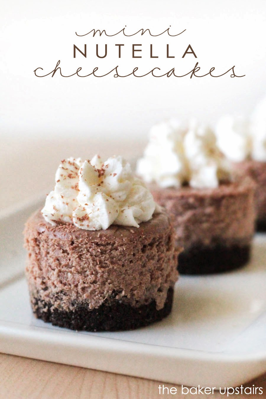 Mini nutella cheesecakes from The Baker Upstairs. Rich, delicious, and silky smooth, these cheesecakes make a beautiful and elegant dessert for any special occasion!