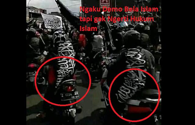 [Kajian Islam] Hukum Menduduki Bendera Bertuliskan Tauhid adalah Haram
