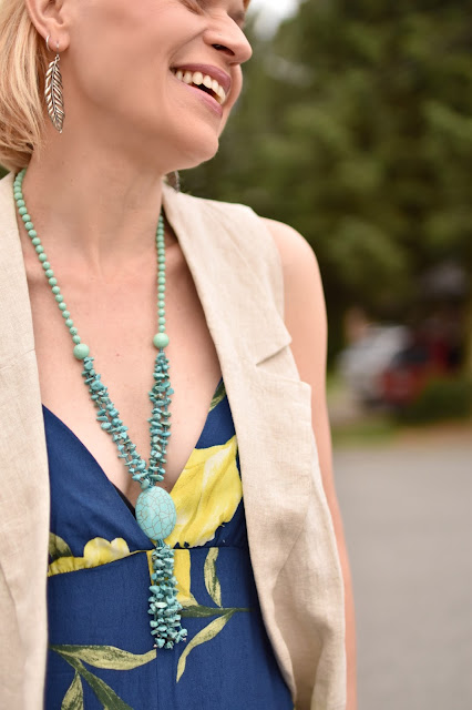 floral jumpsuit, sleeveless linen coat, turquoise necklace