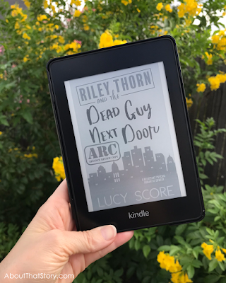 Riley Thorn and the Dead Guy Next Door by Lucy Score | About That Story