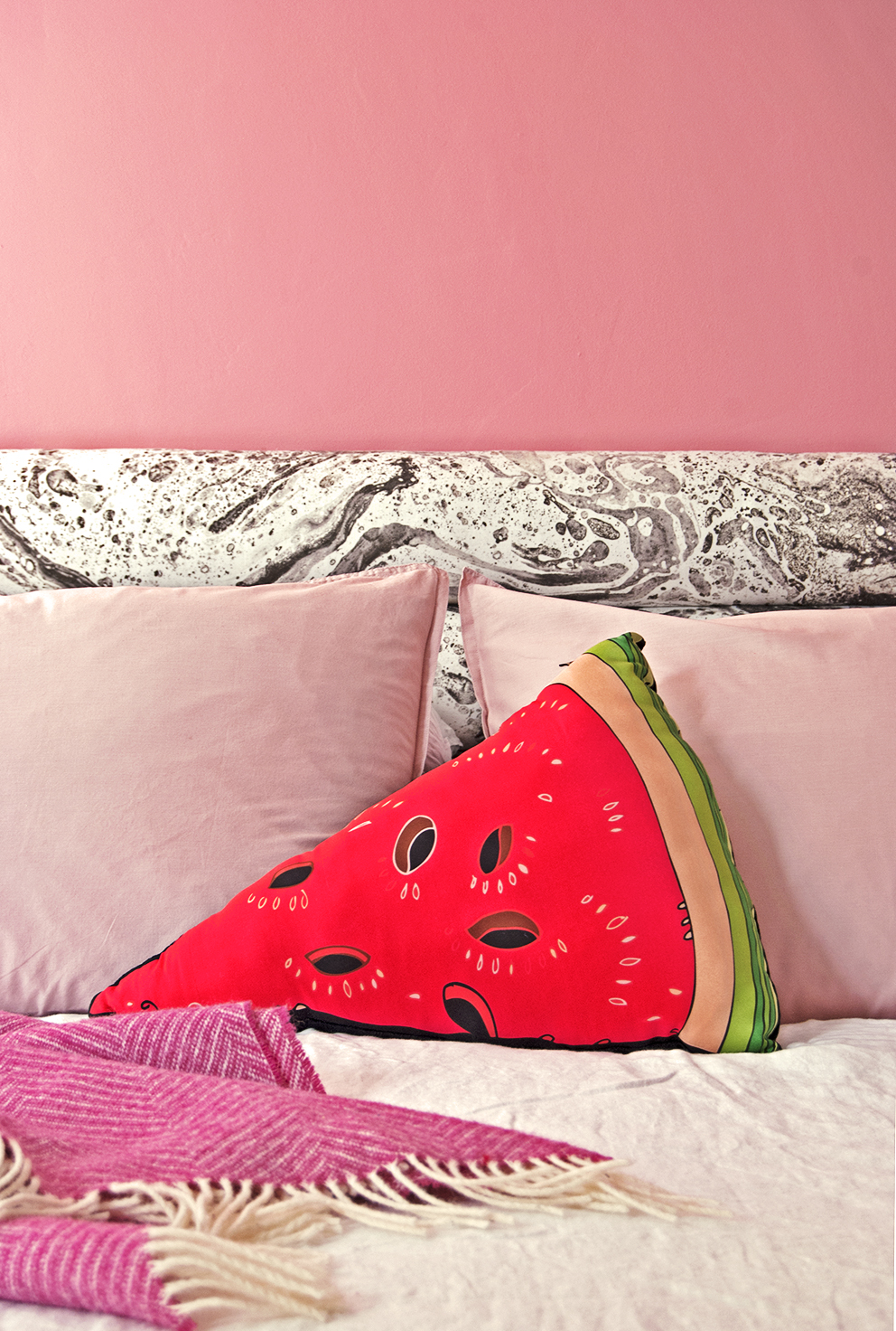 Amara Shoppable Home Inspiration Pages - French For Pineapple Blog - pink walls and pink pillowcases with watermelon cushion and marbled headboard