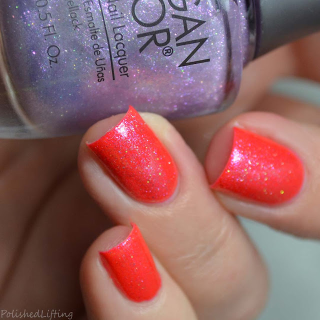 shimmer top coat over neon coral nail polish