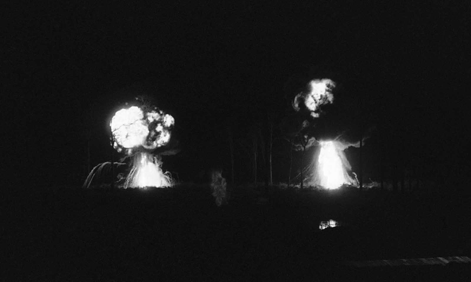 Two napalm drops explode just outside Katum, a U.S. Special Forces camp about 60 miles northwest of Saigon on August 28, 1968. The napalm was used when Viet Cong attacked the camp.