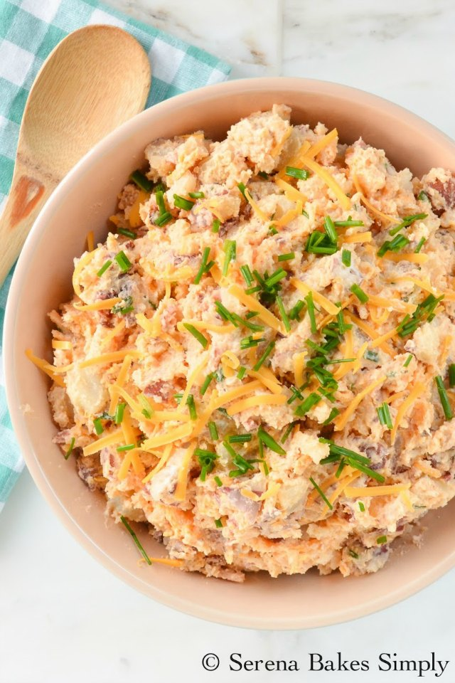 Fully Loaded Baked Potato Salad is a summertime must make for picnics and barbecues. It's loaded with bacon, cheddar cheese, and chives from Serena Bakes Simply From Scratch.