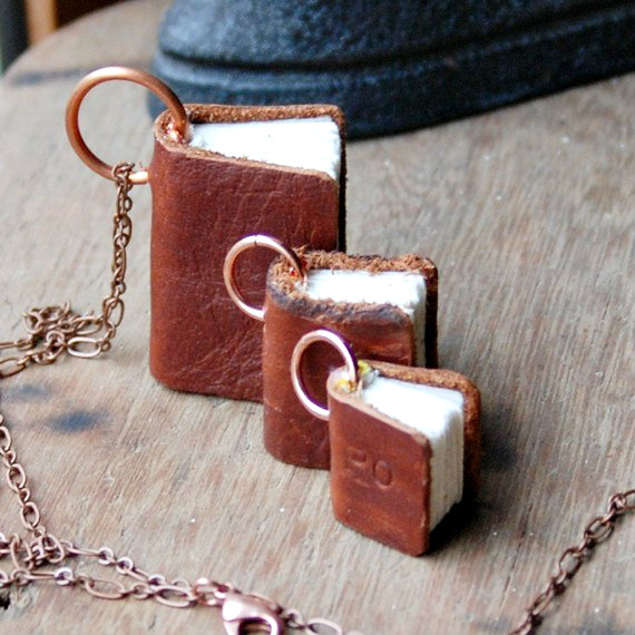 tiny handmade trio of leather and paper book necklaces