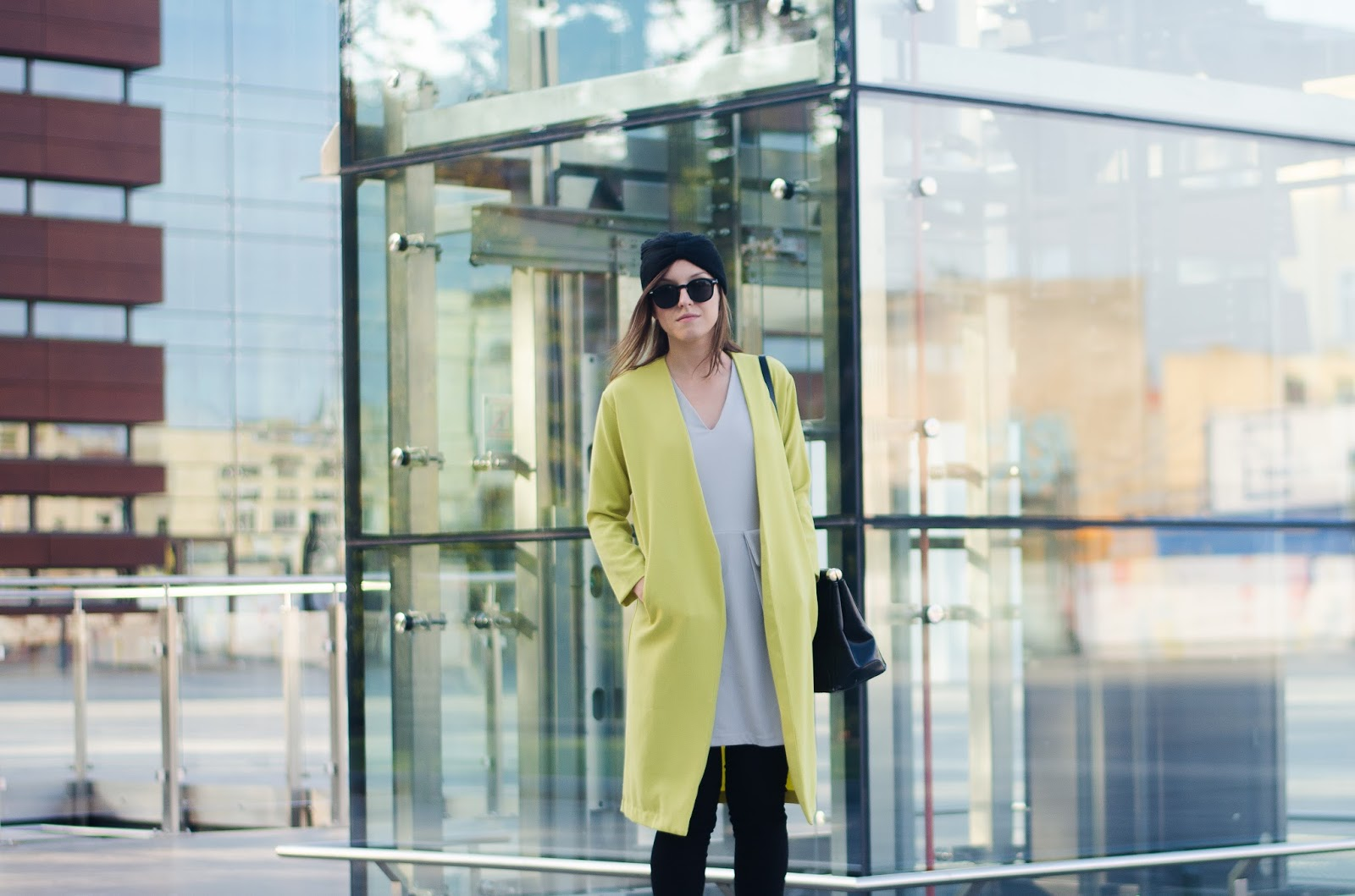 Fashion blogger street syle outfit yellow coat, simple v-neck dress, turban hat and leather slip on sneakers