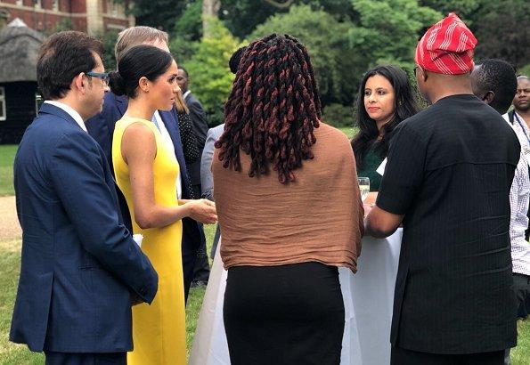 Meghan Markle wore Brandon Maxwell Yellow Crepe Midi Dress, Manolo Blahnik suede pump, Adina Reyter Diamond Amigos Curve Post Earrings