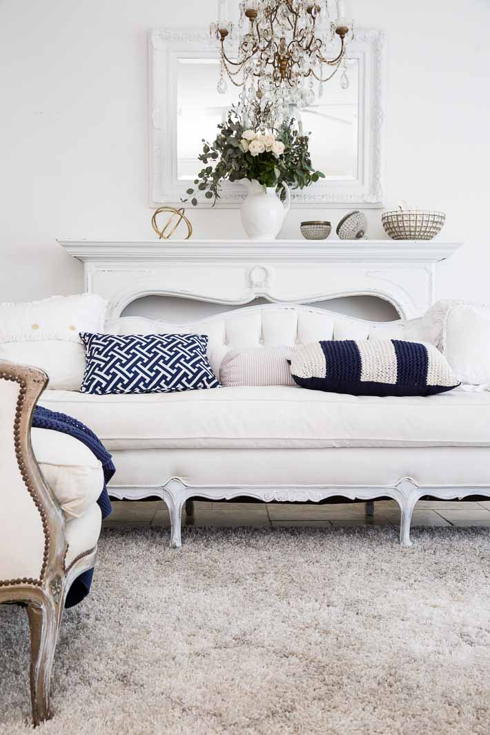 white living room with navy blue accents