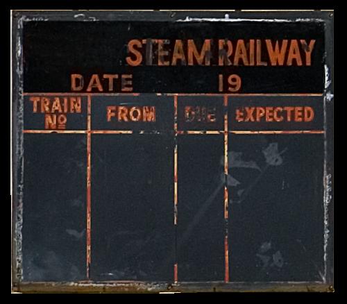 An old railway schedule chalk-board.