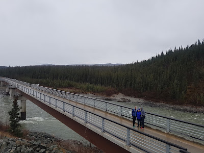 the family standing on a bridge in Nenana Canyon