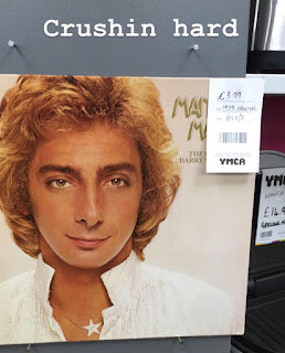 A funny picture of Barry Manilow looking suave