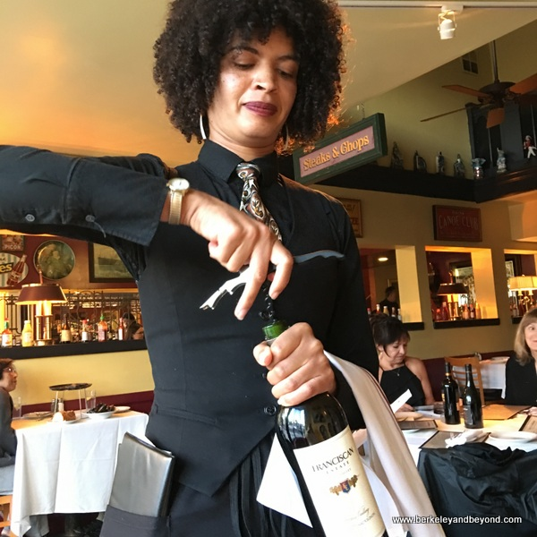 wine-opening at Izzy's Steak & Chop House in Oakland, California