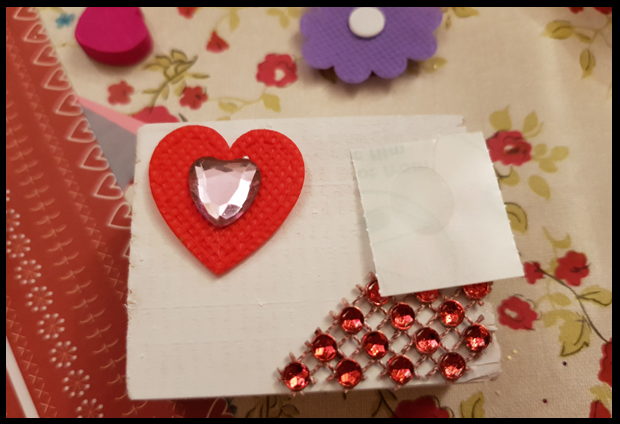 Final lots of lovely red gems, hearts, papers and anything else that takes your fancy to use to decorate the blocks