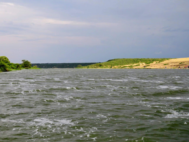 Turbulent waters of the Kazinga Channel in Uganda where is meets the lake