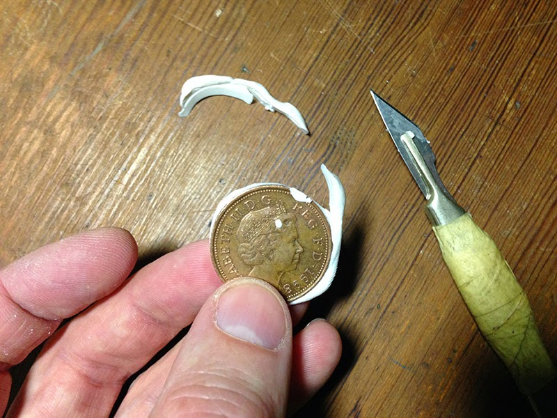 Removing excess fimo with a knife