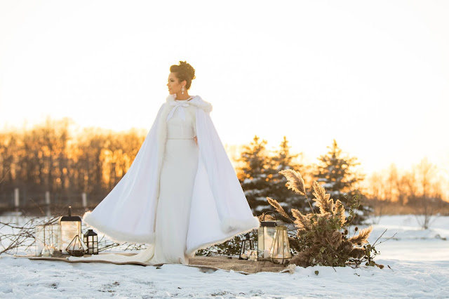 Niagara Wedding Planner - A Divine Affair - Winter Elopement - Lundy Manor Wine Cellars intimate Niagara Falls elopement - boho romantic style with lanterns and candlelight - fireplace with love letter wine box ceremony - photos in the snow at sunset