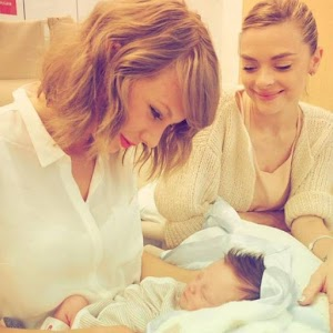 Taylor Swift put picture with the godchild in your arms